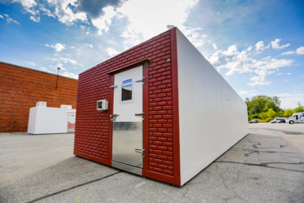 Cooler unit with red brick front and white back