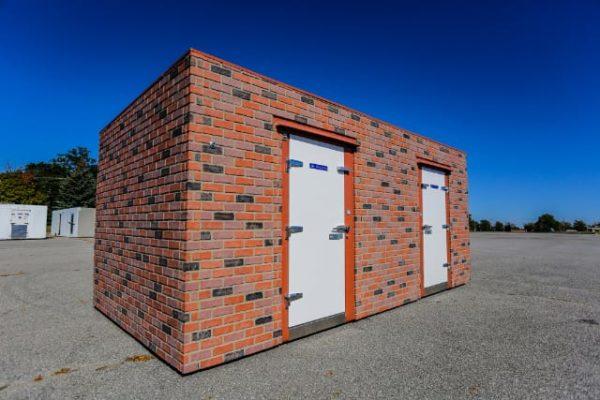 Polar King brick walk-in freezer unit outside on a sunny day