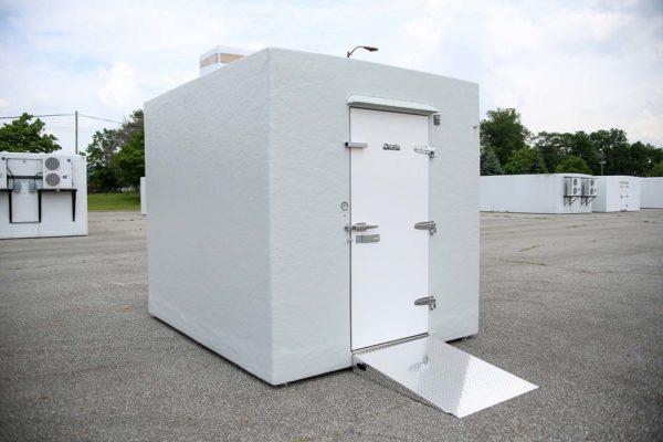 White Polar King freezer unit outside on concrete