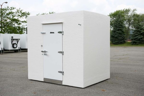 White Polar King walk-in freezer unit on a sunny day