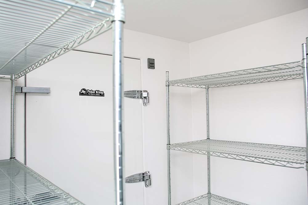 Metal shelving on the inside of a Polar King commercial freezer