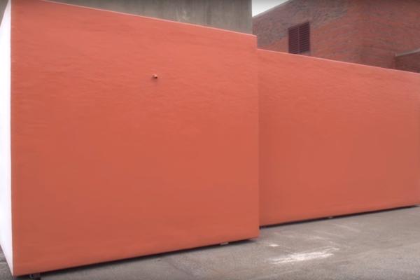 Polar King refrigerated cooler painted orange to match brick exterior