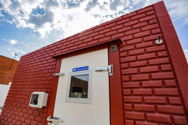 Brick exterior of Polar King walk-in freezer unit