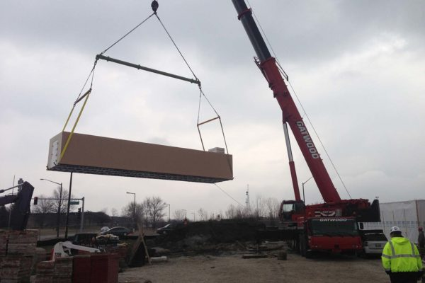 Polar King cooler unit being lifted down on a crane