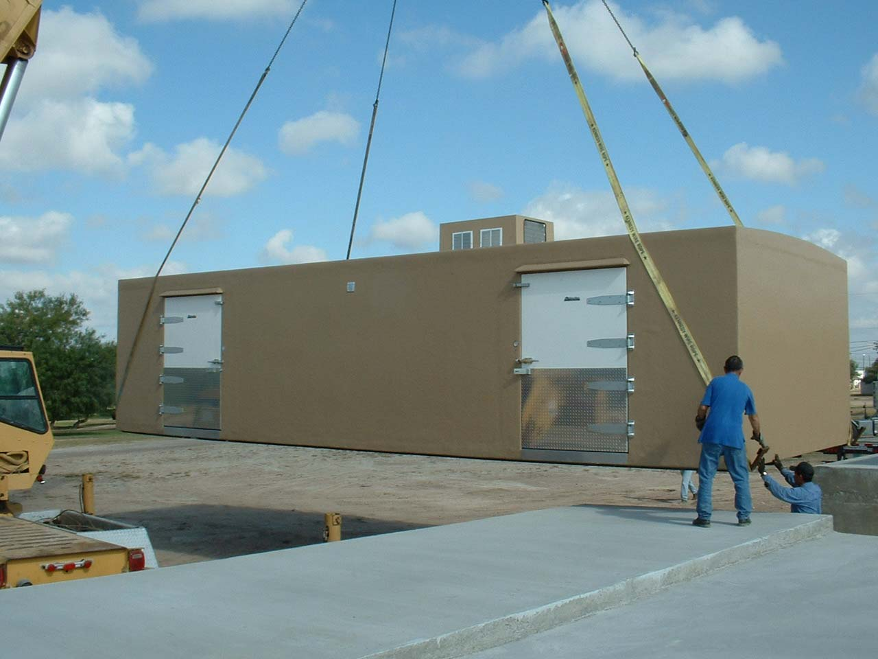 Tan Polar King walk-in cooler unit being delivered