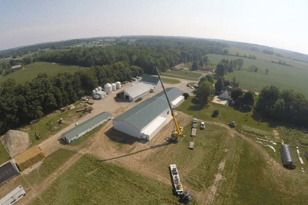 Aerial view of Seven Sons Farm and a crane lifting a walk-in cooler freezer unit